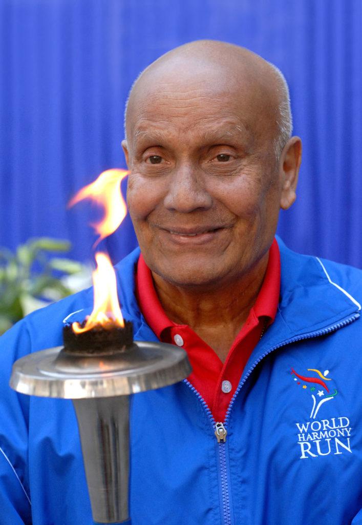 Sri Chinmoy with torch. World harmony run.